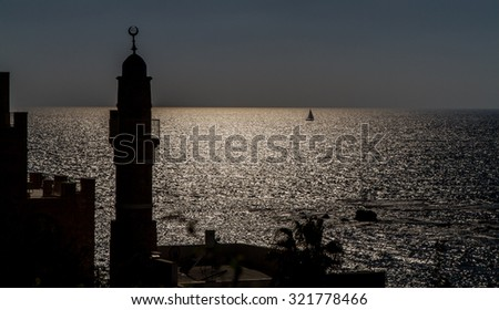 Silhouette of minaret in Old Jaffa against the sea, view at twilight