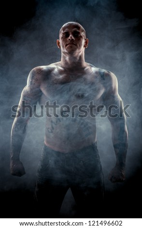 Silhouette of muscular man - stock photo