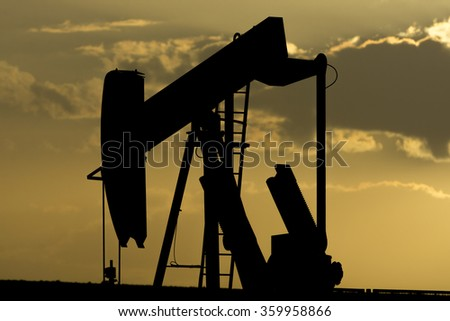 Silhouette of Oil pump in the desert of Bahrain, Middle East.