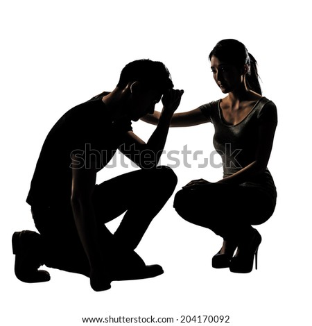 Silhouette of one sad Asian man squat and his wife give comfort to him, full length portrait isolated on white background. - stock photo