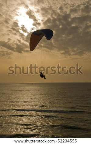 Silhouette of Para-glider, on sunset