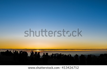 Silhouette of people with Sunrise and sky Background - stock photo