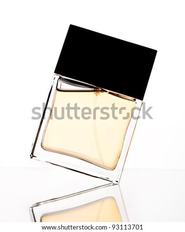 Silhouette of perfume bottle on a white backdrop - stock photo