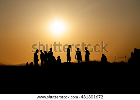 Silhouette of person at sunset in Naxos, Greece