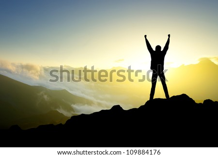 Silhouette of person in mountain. Sport and active life - stock photo