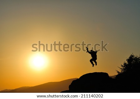 Silhouette of photographer in sunset. - stock photo