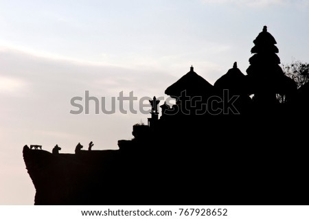 Silhouette of Pura Tanah Lot at sunset, famous hindu temple in South of Bali, Indonesia