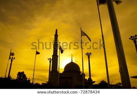 Silhouette of Putra Mosque in sunset. Putrajaya, Malaysia. - stock photo