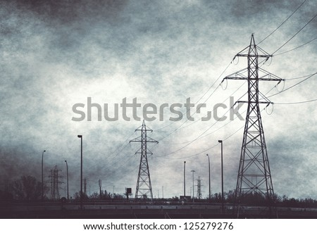 silhouette of pylons against night sky , electricity industry - stock photo