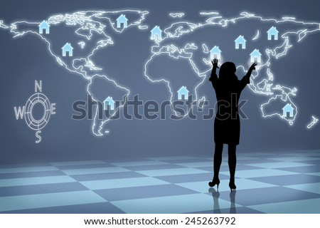 Silhouette of real estate industry future business woman moving houses around map of the world  - stock photo