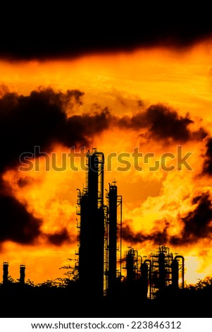 silhouette of refinery plant on evening background - stock photo