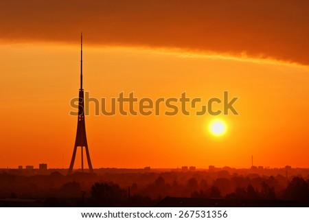 Silhouette of Riga Radio and TV Tower during the sunrise - stock photo