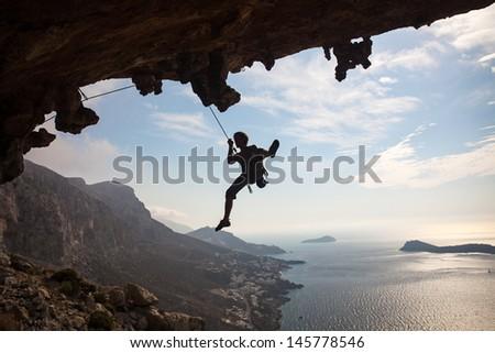 Silhouette of rock climber against sky, Kalymnos Island, Greece - stock photo