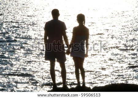 Silhouette of romantic couple at sunset