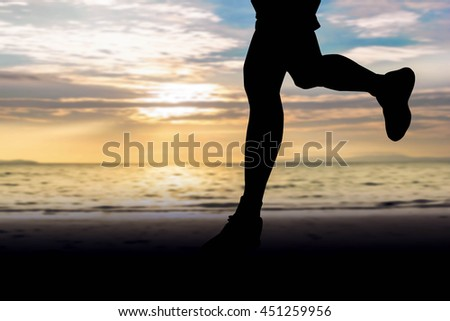 silhouette of runner on blurred beautiful beach background