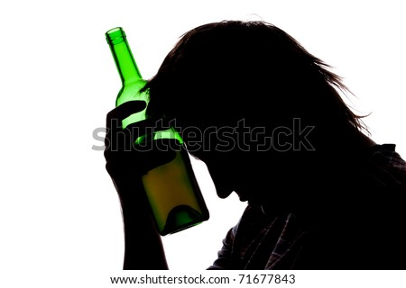 Silhouette of sad man drinking alcohol. Isolated on white - stock photo