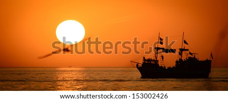 Silhouette of sailing ship in the Atlantic ocean, Key West, Monroe County, Florida, USA - stock photo