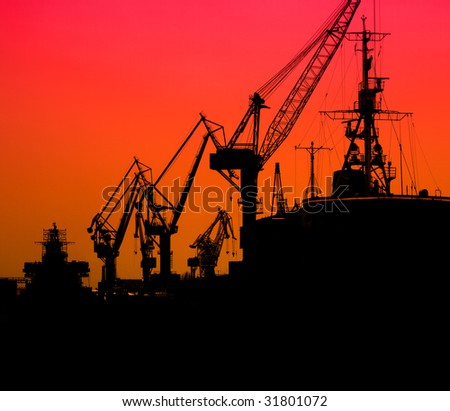 Silhouette of sea port cranes in the morning, St.Petersburg, Russia - stock photo