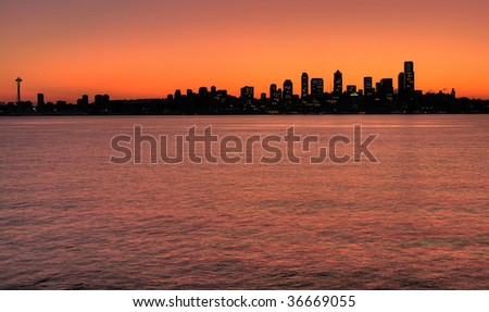 Silhouette of Seattle skyline before sunrise from Alki point - stock photo