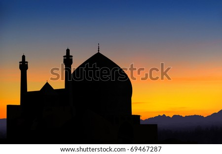Silhouette of Shah mosque view from Ali Qapu palace in Isfahan at sunset, Iran