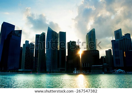 Silhouette of Singapore Downtown Core at sunset - stock photo