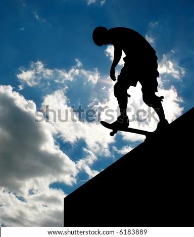 Silhouette of skateboarder on ramp 3 - stock photo