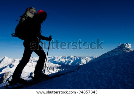 Silhouette of ski mountaineer in winter Alps - stock photo