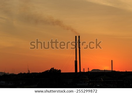 Silhouette of Smokestacks at sunset time in Phuket, Thailand - stock photo