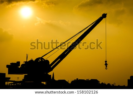 silhouette of stationary harbor crane - stock photo