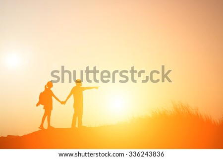 Silhouette of sweet couple walking to travel - stock photo