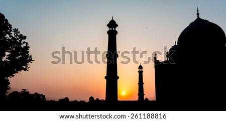 Silhouette of Taj Mahal. The Taj Mahal is the epitome of Mughal art and one of the most famous buildings in the world, it is an UNESCO world heritage site. - stock photo
