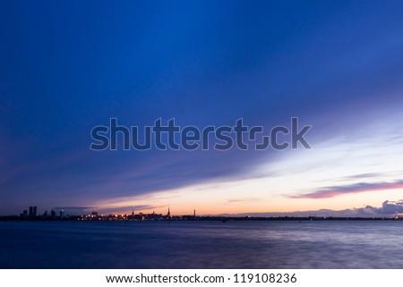 silhouette of Tallinn Estonia with fire sea sunset - stock photo