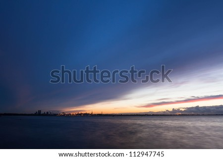 silhouette of tallinn with fire sea sunset. long exposure