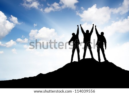 Silhouette of team on the summit. Sport and active life - stock photo