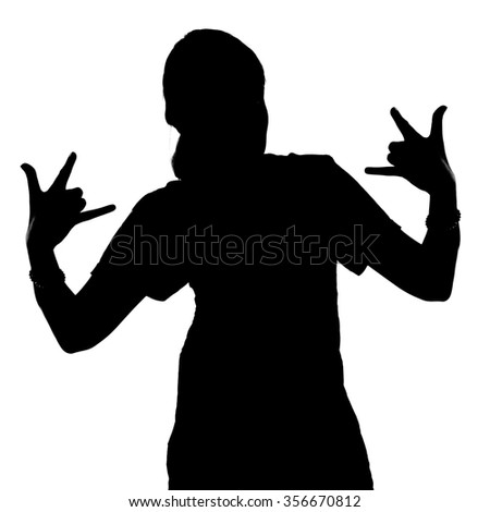 Silhouette of teenage girl with arms Giving The Rock And Roll Sign on white background - stock photo