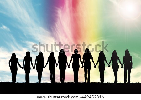 Silhouette of ten young women, walking hand in hand under a rainbow sky.