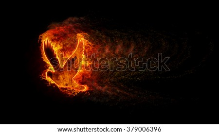 Silhouette of the bird with the flames of fire and explosion with lots of sparks - stock photo