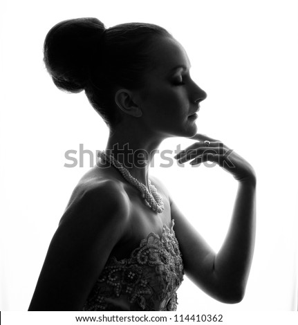 Silhouette of the bride weared in dress over white background - stock photo