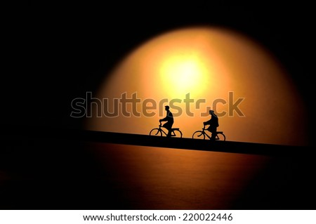 Silhouette of the cyclist.  Silhouette bike cyclist miniature.