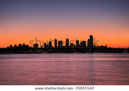silhouette of the emerald city - Seattle skyline over pre-dawn sky - stock photo