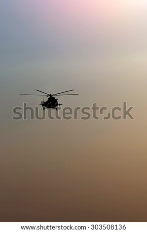 silhouette of the helicopter  - stock photo