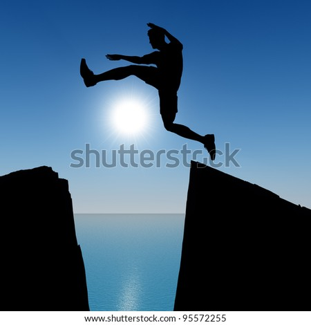 Silhouette of the jumping man from a rock. A shining sun with beams