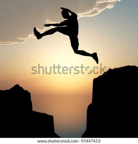 Silhouette of the jumping man from a rock. A sunset - stock photo
