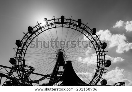 Silhouette of the old Giant Ferris Wheel in the amusement park Prater in Vienna, Austria. Toned. - stock photo