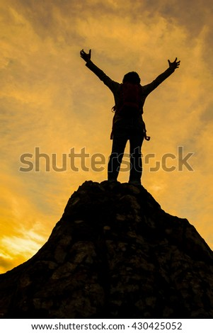 Silhouette of the person on hilltop ,concept for successful and peaceful
