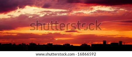 Silhouette of the roofs of houses at sunset.
