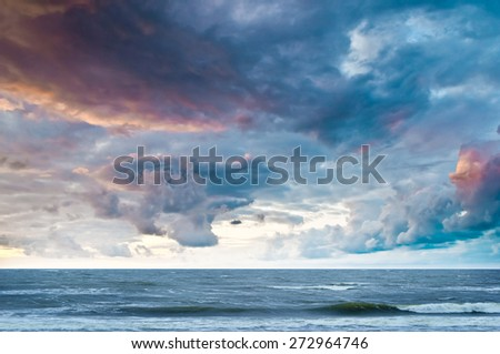 Silhouette of the sea during sunset with beautiful colorful sky  - stock photo