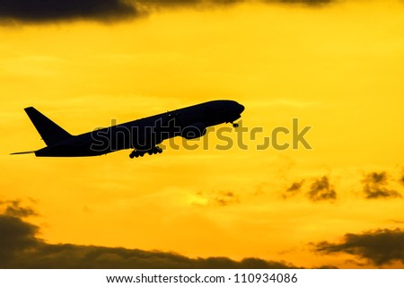 Silhouette of the taking-off aircraft - stock photo