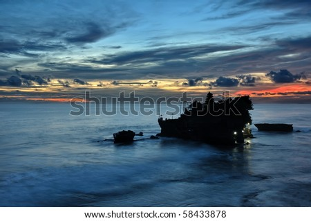 Silhouette of the Tanah Lot Temple in Bali - stock photo