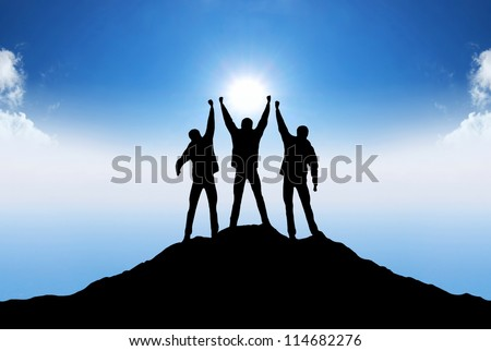 Silhouette of the team on mountain summit. Concept and idea - stock photo